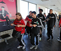 Wednesday 07 August 2013<br /> Pictured: Leon Britton (C), Wilfried Bony (2nd R) and Ashley Williams (R) about to board their aeroplane at Cardiff Airport.<br /> Re: Swansea City FC travelling to Sweden for their Europa League 3rd Qualifying Round, Second Leg game against Malmo.