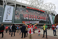 Pictured: A young football supporter with his souvenir scarf posing for a picture outside the Old Trafford. Saturday 16 August 2014<br /> Re: Premier League Manchester United v Swansea City FC at the Old Trafford, Manchester, UK.