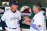 Chicago Cubs Hall of Fame infielder, now coach for the Lehigh Valley IronPigs, Ryne Sandberg talks with fellow hall member Tom Seaver in the dugout before the Triple-A All-Star Game Coca-Cola Field on July 11, 2012 in Buffalo, New York.  The Pacific Coast League defeated the International League 3-0.  (Mike Janes/Four Seam Images via AP Images)