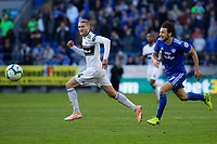 (L-R) Andre Schurrle of Fulham is chased by Harry Arter of Cardiff City during the Premier League match between Cardiff City and Fulham FC at the Cardiff City Stadium, Wales, UK. Saturday 20 October 2018