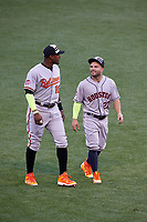 Baltimore Orioles Adam Jones and Houston Astros Jose Altuve during warmups before the MLB All-Star Game on July 14, 2015 at Great American Ball Park in Cincinnati, Ohio.  (Mike Janes/Four Seam Images)