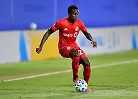 LAKE BUENA VISTA, FL - JULY 26: Richie Laryea of Toronto FC dribbles the ball during a game between New York City FC and Toronto FC at ESPN Wide World of Sports on July 26, 2020 in Lake Buena Vista, Florida.