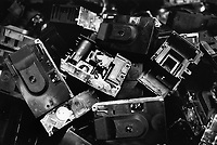 """France. Saône-et-Loire department. Chalon-sur-Saône. Kodak factory. Camera recycling. The """"ready to take pictures"""" camera is a small camera commonly described as disposable but in fact assembled for customers to return it after use. After being dismantled, verified and meticulously cleaned, some pieces are reused, other recycled (86%). The plastics parts are torn, melted, recasted and then reassembled. Eastman Kodak Company. Chalon-sur-Saône is located in the south of the Burgundy region. © 1996 Didier Ruef ."""