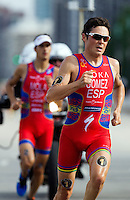 29 JUN 2014 - CHICAGO, USA - Javier Gomez (ESP) (right) of Spain leads Mario Mola (ESP), also of Spain during the run at the elite men's ITU 2014 World Triathlon Series round in Grant Park, Chicago in the USA (PHOTO COPYRIGHT © 2014 NIGEL FARROW, ALL RIGHTS RESERVED)