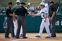 Dartmouth Big Green head coach Bob Whalen (2) shakes hands with umpire Mike Trotter after the lineup exchange with South Florida Bulls head coach Mark Kingston (back), as Mike Schaeffer (left) and Chris Tipton (right) look on before a game on March 27, 2016 at USF Baseball Stadium in Tampa, Florida.  South Florida defeated Dartmouth 4-0.  (Mike Janes/Four Seam Images)