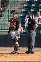 Delmarva Shorebirds catcher Yermin Mercedes (17) and home plate umpire Donnie Smith during the game against the Hickory Crawdads at L.P. Frans Stadium on June 18, 2016 in Hickory, North Carolina.  The Crawdads defeated the Shorebirds 1-0 in game one of a double-header.  (Brian Westerholt/Four Seam Images)