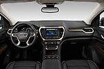 Stock photo of straight dashboard view of 2020 GMC Acadia Denali 5 Door SUV Dashboard