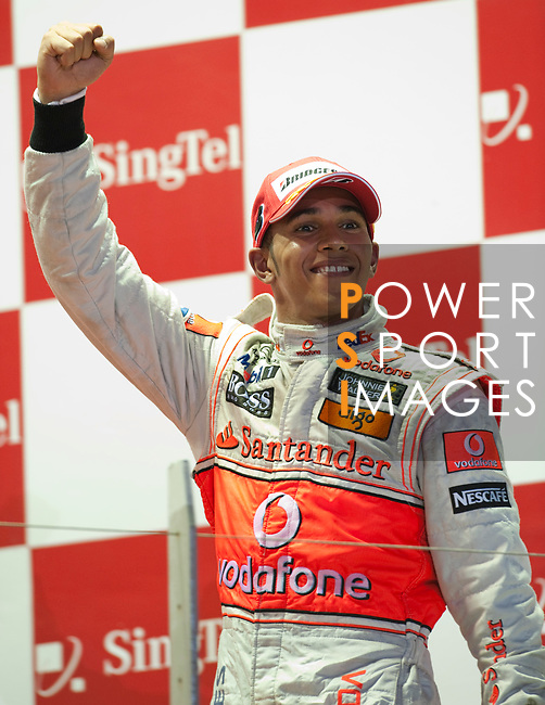 27 Sept 2009, Singapore --- Vodafone McLaren Mercedes F1 Team driver Lewis Hamilton of Great Britain celebrates on the podium after winning the Fia Formula One 2009 Singtel Singapore Grand Prix, the world's only street night race, at the Marina Bay street circuit. Photo by Victor Fraile --- Image by © Victor Fraile/Corbis