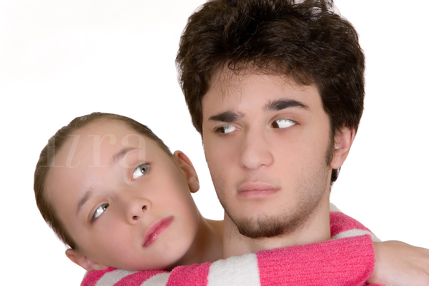 A boy and girl pose as brother and sister.