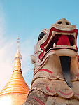 Temple and Chinthe; mythical lion-dragon creatures, Bagan, Burma