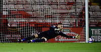 Lincoln City's Ethan Ross saves a penalty taken by Manchester City U21's Keyendrah Simmonds in the penalty shoot out<br /> <br /> Photographer Chris Vaughan/CameraSport<br /> <br /> EFL Papa John's Trophy - Northern Section - Group E - Lincoln City v Manchester City U21 - Tuesday 17th November 2020 - LNER Stadium - Lincoln<br />  <br /> World Copyright © 2020 CameraSport. All rights reserved. 43 Linden Ave. Countesthorpe. Leicester. England. LE8 5PG - Tel: +44 (0) 116 277 4147 - admin@camerasport.com - www.camerasport.com