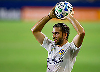 CARSON, CA - SEPTEMBER 19: Emiliano Insua #3 of the Los Angeles Galaxy with a throw in during a game between Colorado Rapids and Los Angeles Galaxy at Dignity Heath Sports Park on September 19, 2020 in Carson, California.