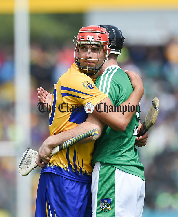 Peter Duggan of Clare and Diarmaid Byrnes of Limerick embrace following their Munster championship game against Limerick in Ennis. Photograph by John Kelly.
