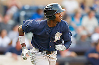 Domonic Brown #9 of the Lehigh Valley IronPigs hustles down the first base line against the Durham Bulls at Durham Bulls Athletic Park June 26, 2010, in Durham, North Carolina.  Photo by Brian Westerholt / Four Seam Images