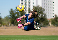ORLANDO, FL - JANUARY 20: Alyssa Naeher #1 of the USWNT makes a save during a training session at the practice fields on January 20, 2021 in Orlando, Florida.