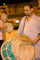 """Tripoli, Libya.  Muslim Wedding Celebrations.  Wedding Musicians Play the """"Taddridja"""" while escorting the groom to meet his new wife on their first night together."""