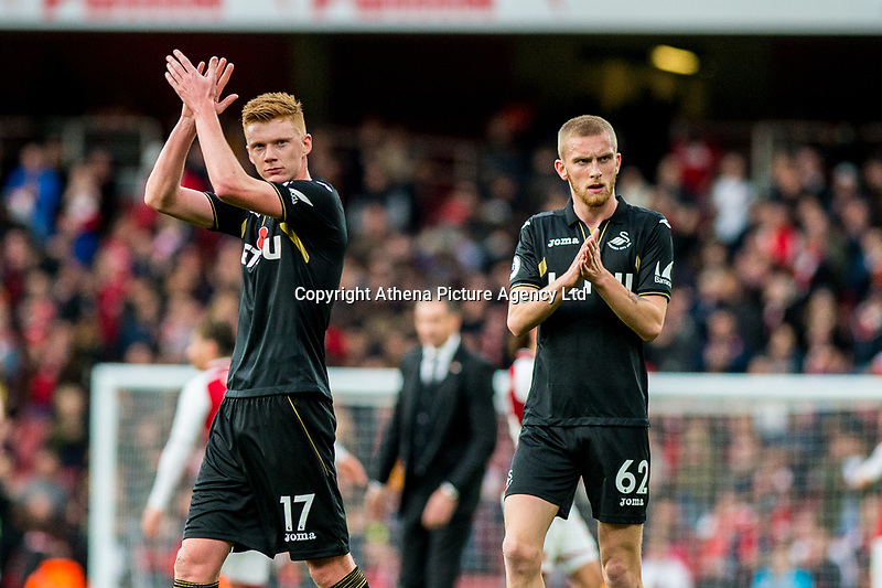 Sam Clucas of Swansea City and Oliver McBurnie applaud fans during the Premier League match between Arsenal and Swansea City at Emirates stadium, London, England, UK. Saturday 28 October 2017