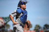 SAN FRANCISCO, CA - AUGUST 27:  Kyle Schwarber #12 of the Chicago Cubs works behind the plate against the San Francisco Giants during the game at AT&T Park on Thursday, August 27, 2015 in San Francisco, California. Photo by Brad Mangin
