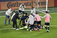 KANSAS CITY, KS - NOVEMBER 22: Sporting Kansas  City players celebrate penalty shoot out win with goalkeeper Tim Melia during a game between San Jose Earthquakes and Sporting Kansas City at Children's Mercy Park on November 22, 2020 in Kansas City, Kansas.