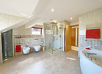 BNPS.co.uk (01202) 558833. <br /> Pic: LillicrapChilcott/BNPS<br /> <br /> Pictured: Principal en-suite. <br /> <br /> An impressive waterfront home with panoramic views over one of Britain's most popular estuaries is on the market for £2.75m.<br /> <br /> Tregytreath is the perfect property for boat lovers, with access to the foreshore and its own private jetty onto the water.<br /> <br /> The five-bedroom house is in Restronguet Point, one of the most exclusive waterside locations in Cornwall, and this property has one of the most outstanding positions among those prestigious homes.<br /> <br /> The house was designed and built, by the current owners 20 years ago, to make the most of the beautiful views.