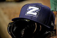 A detailed view of a New Orleans Zephyrs player hat and glove in the dugout during a game against the Albuquerque Isotopes at Zephyr Field on May 28, 2015 in Metairie, Louisiana. (Derick E. Hingle/Four Seam Images)