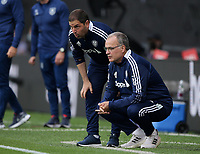 29th August 2021; Turf Moor, Burnley, Lancashire, England; Premier League football, Burnley versus Leeds United: Leeds United manager Marco Bielsa consults his fellow Argentinian assistant Pablo Quiroga