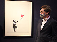 Banksy, Girl with Balloon. Estimate: £120,000 - 180,000 at the Preview of Bonhams' Prints & Multiples sale. New Bond Street, London on Thursday December 10th 2020<br /> <br /> Photo by Keith Mayhew