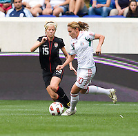 Megan Rapinoe, Dinora Garza. The USWNT defeated Mexico, 1-0, during the game at Red Bull Arena in Harrison, NJ.