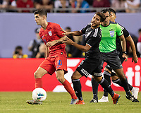 CHICAGO, IL - JULY 7: Christian Pulisic #10 dribbles away from Jonathan Dos Santos #6 during a game between Mexico and USMNT at Soldiers Field on July 7, 2019 in Chicago, Illinois.