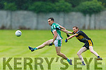 Jack Barry of Na Gaeil releases his effort as Timmie O'Leary of Currow attempts to challenge him, in the Intermediate Club Championship