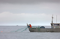 Commercial Gill net fishermen on the Copper River Delta during a 12 hour fishing period.