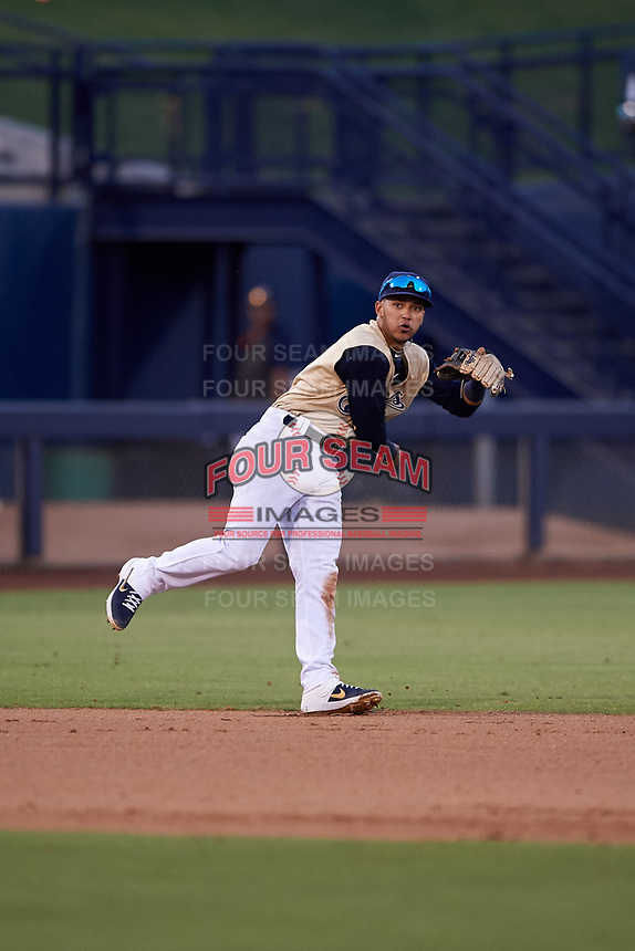 AZL Brewers Gold shortstop Daniel Castillo (13) throws to first base during an Arizona League game against the AZL Brewers Blue on July 13, 2019 at American Family Fields of Phoenix in Phoenix, Arizona. The AZL Brewers Blue defeated the AZL Brewers Gold 6-0. (Zachary Lucy/Four Seam Images)