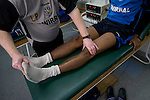 Tranmere Rovers Club Physiotherapist Les Parry, 10/03/2008. Prenton Park, League One. Tranmere Rovers' club physio Les Parry in the club's treatment room assessing the damage to captain Ian Goodison's knee which had been injured two days earlier in a match at Oldham. Les Parry has been the club physiotherapist since 1993 and recently completed 800 games with the club. At the time he was also working on completing his PhD at Liverpool John Moores University. Photo by Colin McPherson.