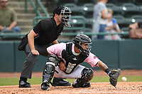 Hickory Crawdads catcher Melvin Novoa (32) catches a pitch during the game with the Charleston Riverdogs at L.P. Frans Stadium on May 12, 2019 in Hickory, North Carolina.  The Riverdogs defeated the Crawdads 13-5. (Tracy Proffitt/Four Seam Images)