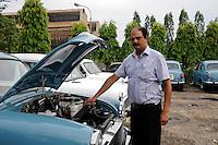 INDIA Kolkata Calcutta , HM Hind Motors car factory, here the Ambassador is still produced after license of Oxford Morris, new painted blue cars for the navy / INDIEN Kolkata Kalkutta , Fabrik HM Hind Motors, Herstellung von Ambassador , der HM Ambassador laeuft heute noch neu nach Vorlage des Oxford Morris bei HM Hindustan Motors vom Band