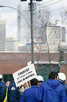 October 19, 1987 File Photo - Employees of Canada Post protest the use if scabs that are bused into the Ottawa street treatment center.<br /> <br /> Des employes de Poste Canada tente d'empecher un autobus de briseurs de greve d'acceder au centre de traiteemnt du courriel, sur la rue Ottawa, le 19 Octobre 1987