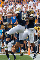Pitt tight end Jim Medure (81) and running back Qadree Ollison celebrate Ollison's 8-yard touchdown run. The Pitt Panthers football team defeated the Georgia Tech Yellow Jackets 24-19 on September 15, 2018 at Heinz Field in Pittsburgh, Pennsylvania.