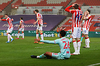 (L-R) Kyle Naughton of Swansea City sits on the ground after winning a penalty from a foul by Jack Clarke of Stoke City during the Sky Bet Championship match between Stoke City and Swansea City at the Bet365 Stadium, Stoke on Trent, England, UK. Wednesday 03 March 2021