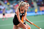 The Hague, Netherlands, June 05: Sophie Cocks #17 of New Zealand fights for the ball with Frederique Derkx #2 of The Netherlands during the field hockey group match (Women - Group A) between New Zealand and The Netherlands on June 5, 2014 during the World Cup 2014 at Kyocera Stadium in The Hague, Netherlands. Final score 0-2 (0-2) (Photo by Dirk Markgraf / www.265-images.com) *** Local caption ***