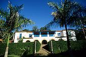 Rio de Janeiro State, Brazil. Fazenda Ponte Alta hotel; white colonial buildings of the hotel.