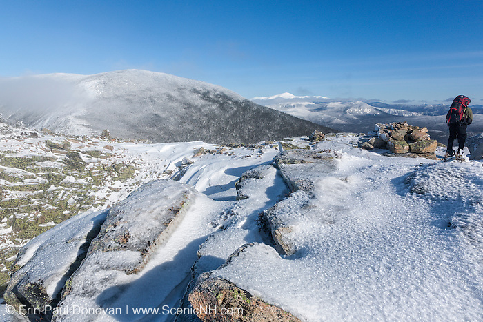 Hiker on the summit of Bondcliff in the Pemigewasset Wilderness of the New Hampshire White Mountains during the winter months. Bondcliff, Mount Bond, and West Bond were named in 1876 for Professor G.P. Bond of Harvard University.