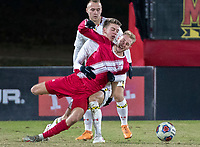 COLLEGE PARK, MD - NOVEMBER 15: Ben Di Rosa #25 of Maryland holds Simon Waever #3 of Indiana during a game between Indiana University and University of Maryland at Ludwig Field on November 15, 2019 in College Park, Maryland.