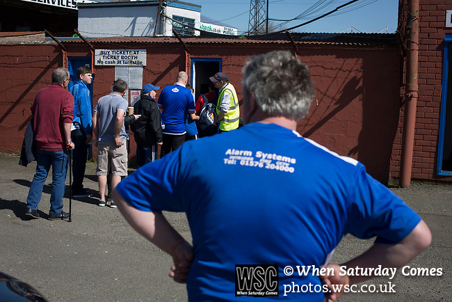 Home fans queueing at a turnstile at Palmerston Park, Dumfries before Queen of the South hosted Dundee United in a Scottish Championship fixture. The home has played at the same ground since its formation in 1919. Queens won the match 3-0 watched by a crowd of 1,531 spectators.