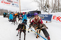 Jessica Klejka handlers hold the dogs back during the restart of the 2019 Iditarod race in Willow, Alaska on Sunday March 3, 2019.<br /> <br /> Photo by Jeff Schultz/  (C) 2019  ALL RIGHTS RESERVED