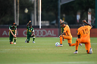 LAKE BUENA VISTA, FL - JULY 18: Houston Dynamo and Portland Timbers players take a knee during a game between Houston Dynamo and Portland Timbers at ESPN Wide World of Sports on July 18, 2020 in Lake Buena Vista, Florida.