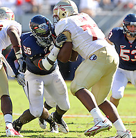 Oct 2, 2010; Charlottesville, VA, USA; Virginia Cavaliers defensive end Cam Johnson (56) goes up against Florida State Seminoles offensive tackle Zebrie Sanders (77) during the game at Scott Stadium. Florida State won 34-14.  Mandatory Credit: Andrew Shurtleff-