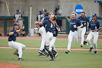 Wingate Bulldogs relief pitcher Sam Broderson (21) jumps into the arms of catcher Logan McNeely (18) after the final out against the Central Missouri Mules during the 2021 DII Baseball National Championship at Coleman Field at the USA Baseball National Training Complex on June 12, 2021 in Cary, North Carolina. The Bulldogs defeated the Mules 5-3. (Brian Westerholt/Four Seam Images)