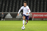SWANSEA, WALES - NOVEMBER 12: Antonee Robinson #5 of the United States  races with the ball during a game between Wales and USMNT at Liberty Stadium on November 12, 2020 in Swansea, Wales.