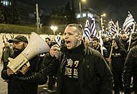MP Ilias Kassidiaris joins members of far right group Golden Dawn (Chrysi Avgi) as they march