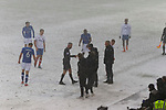 Referee Sebastian Stockridge explains to Oldham Manager Richie Wellens and Portsmouth Manager Kenny Jackett that play is suspended because the touchlines are obscured. Oldham v Portsmouth League 1